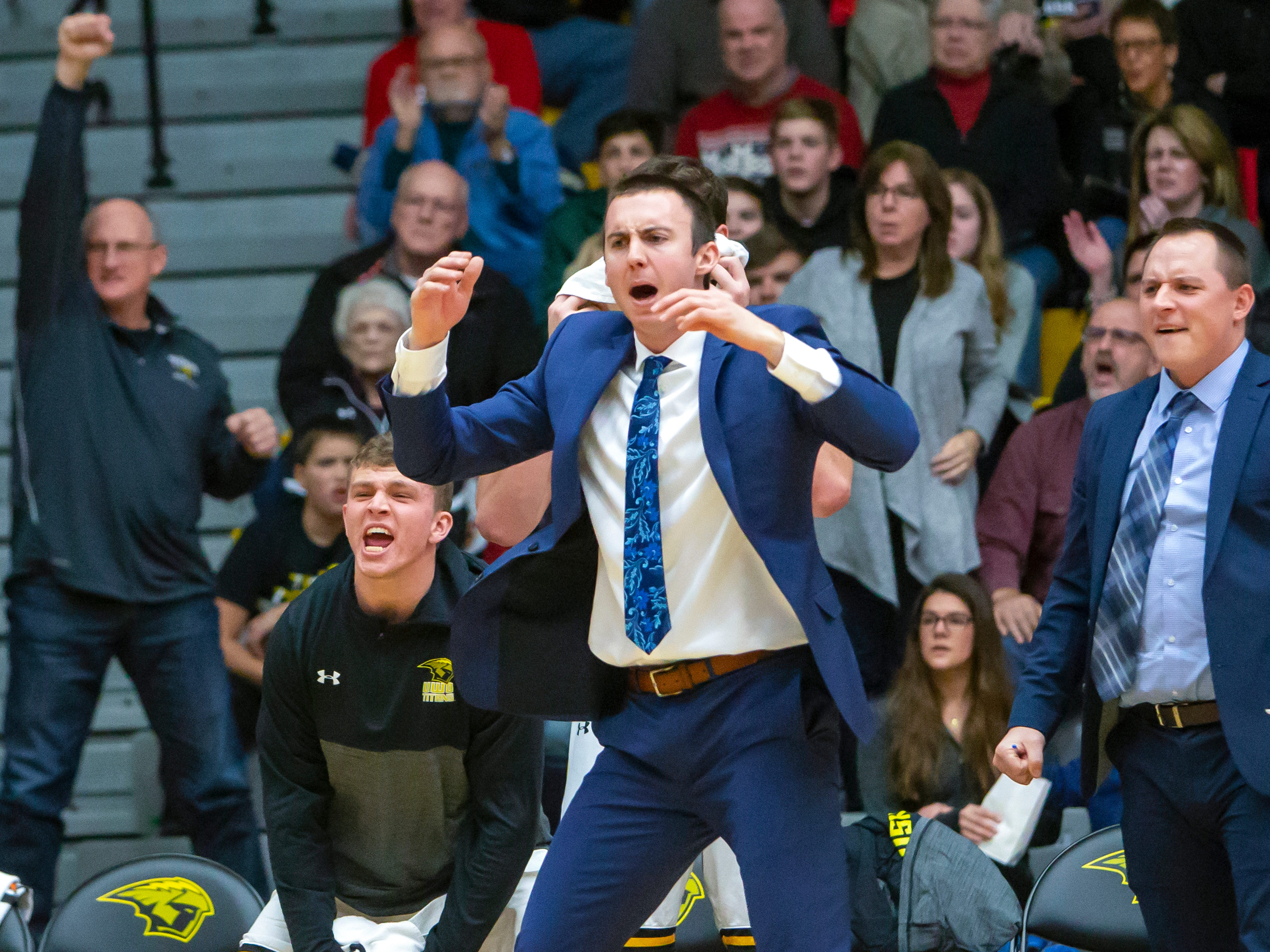 Interim head coach Matt Lewis of UW-Oshkosh reacts to a play on the court at the Kolf Sports Center on Saturday, December 8, 2018.
