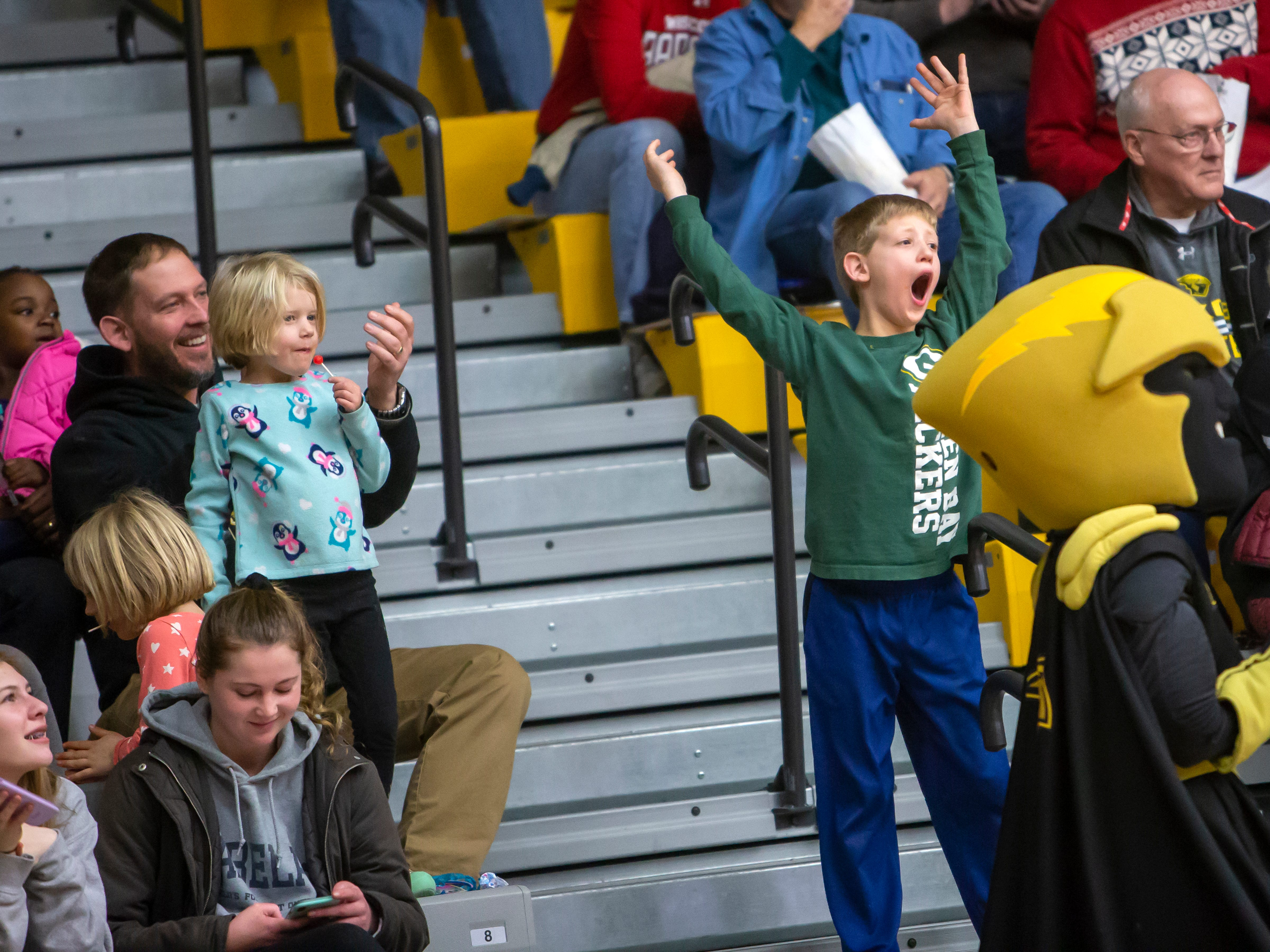 Donald Morrison in the crowd reacts to the halftime entertainment at the Kolf Sports Center on Saturday, December 8, 2018.