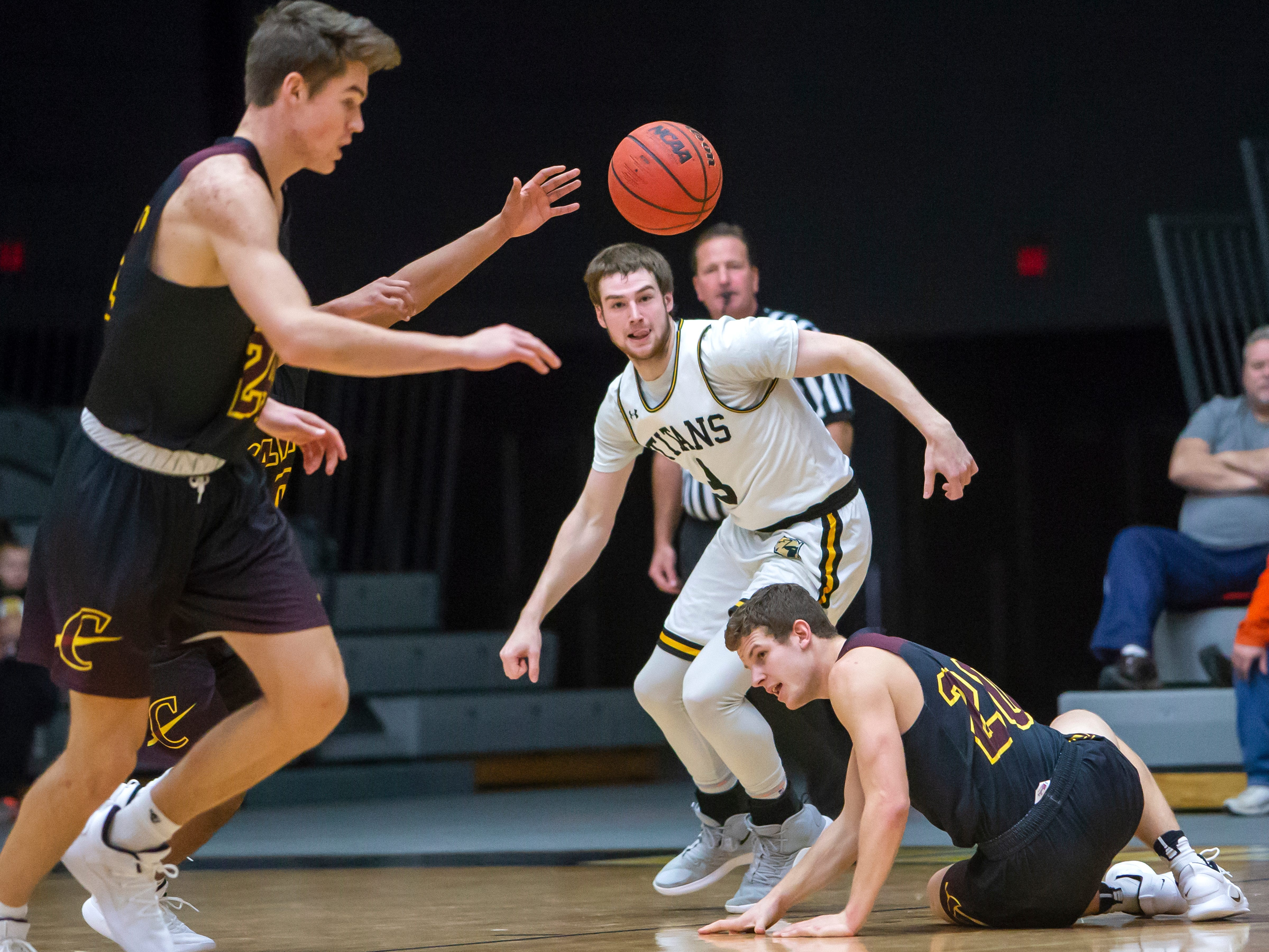 UW-Oshkosh's David Vlotho turns in the direction of the loose ball playing against Calvin College at the Kolf Sports Center on Saturday, December 8, 2018.