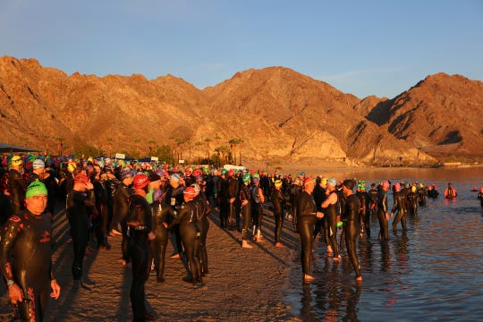 Racers line up at the edge of Lake Cahuilla for the swim portion of the 2018 Ironman 70.3 Indian Wells, La Quinta. The triathlon returns on Sunday, December 8, 2019, with a new path for the 56-mile bike route officials say will have less impact on residents and businesses.