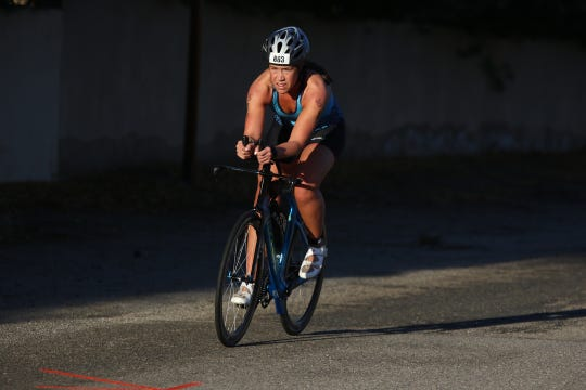 Scenes from the inaugural IRONMAN 70.3 Indian Wells La Quinta triathlon. It began at Lake Cahuilla Sunday morning and ended at the Indian Wells Tennis Garden.