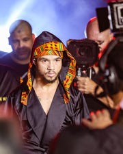 Patricio Manuel, making the walk from the locker room to the ring, posted a unanimous decision victory over Hugo Aguilar in the 128-pound super featherweight division bout Saturday night, Dec. 8, 2018, at Fantasy Springs Casino in Indio, California. Manuel became the first transgender male to compete as a pro boxer in the United States.