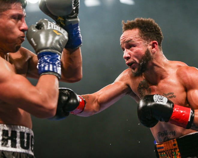 Patricio Manuel, right, lands a shot against Hugo Aguilar in the 128-pound super featherweight division bout Saturday night, Dec. 8, 2018, at Fantasy Springs Casino in Indio, California. Manuel became the first transgender male to compete as a pro boxer in the United States.