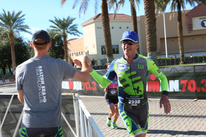 Scenes from the inaugural IRONMAN 70.3 Indian Wells La Quinta triathlon from Lake Cahuilla Sunday morning.