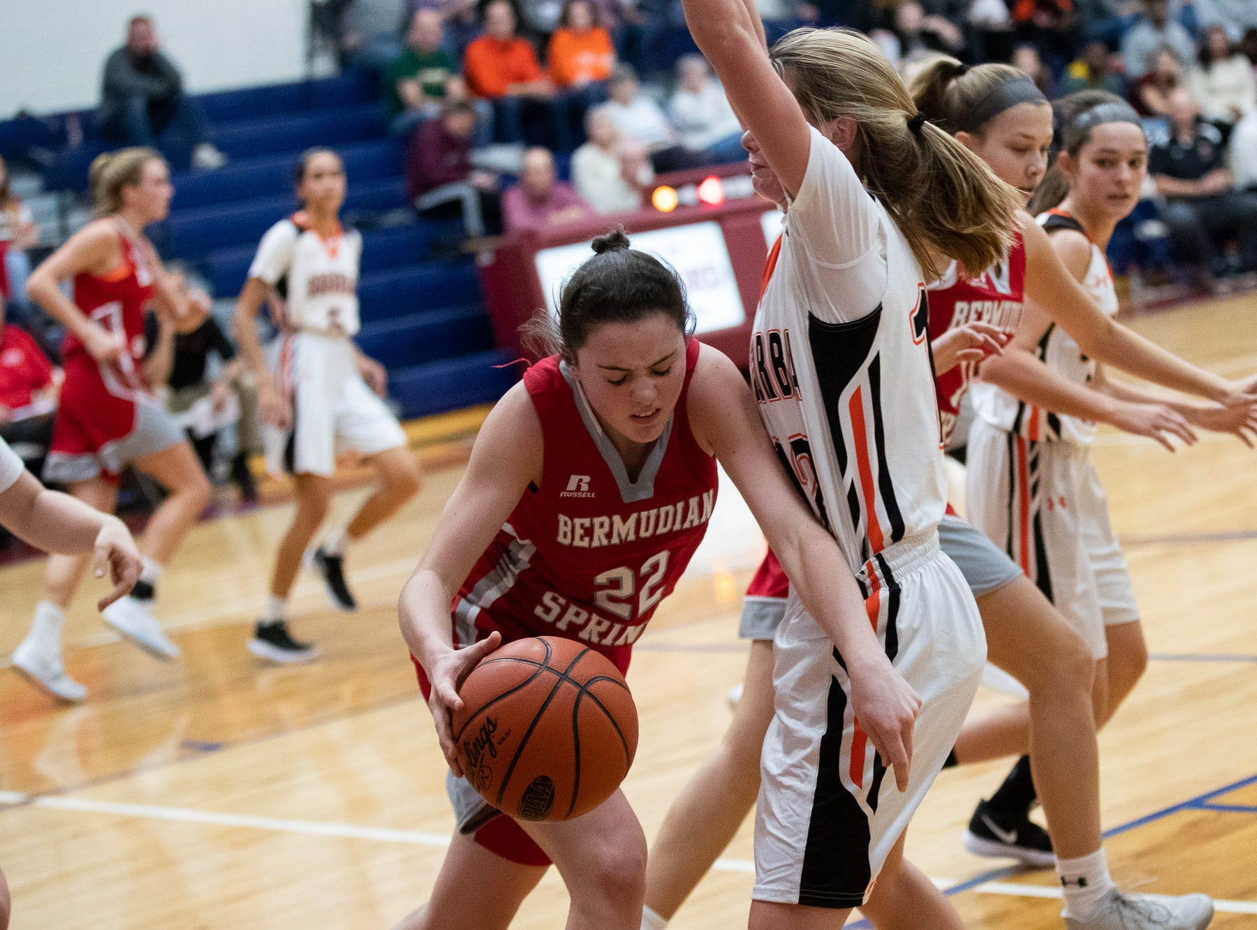 Bermudian Springs' Lilian Peters (22) drives the ball around the York Suburban defense during the consolation game between Bermudian Springs and York Suburban during the New Oxford Girls Basketball Tip-Off Tournament, Saturday, Dec. 8, 2018, in New Oxford. The Bermudian Springs Lady Eagles defeated the York Suburban Lady Trojans 60-58.