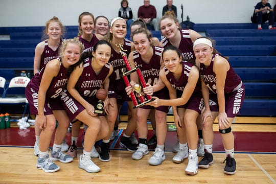 The Gettysburg Lady Warriors pose for a photo with their trophy after winning the championship game between New Oxford and Gettysburg at the New Oxford Girls Basketball Tip-Off Tournament, Saturday, Dec. 8, 2018, in New Oxford. The Gettysburg Lady Warriors defeated the New Oxford Lady Colonials 47-40.