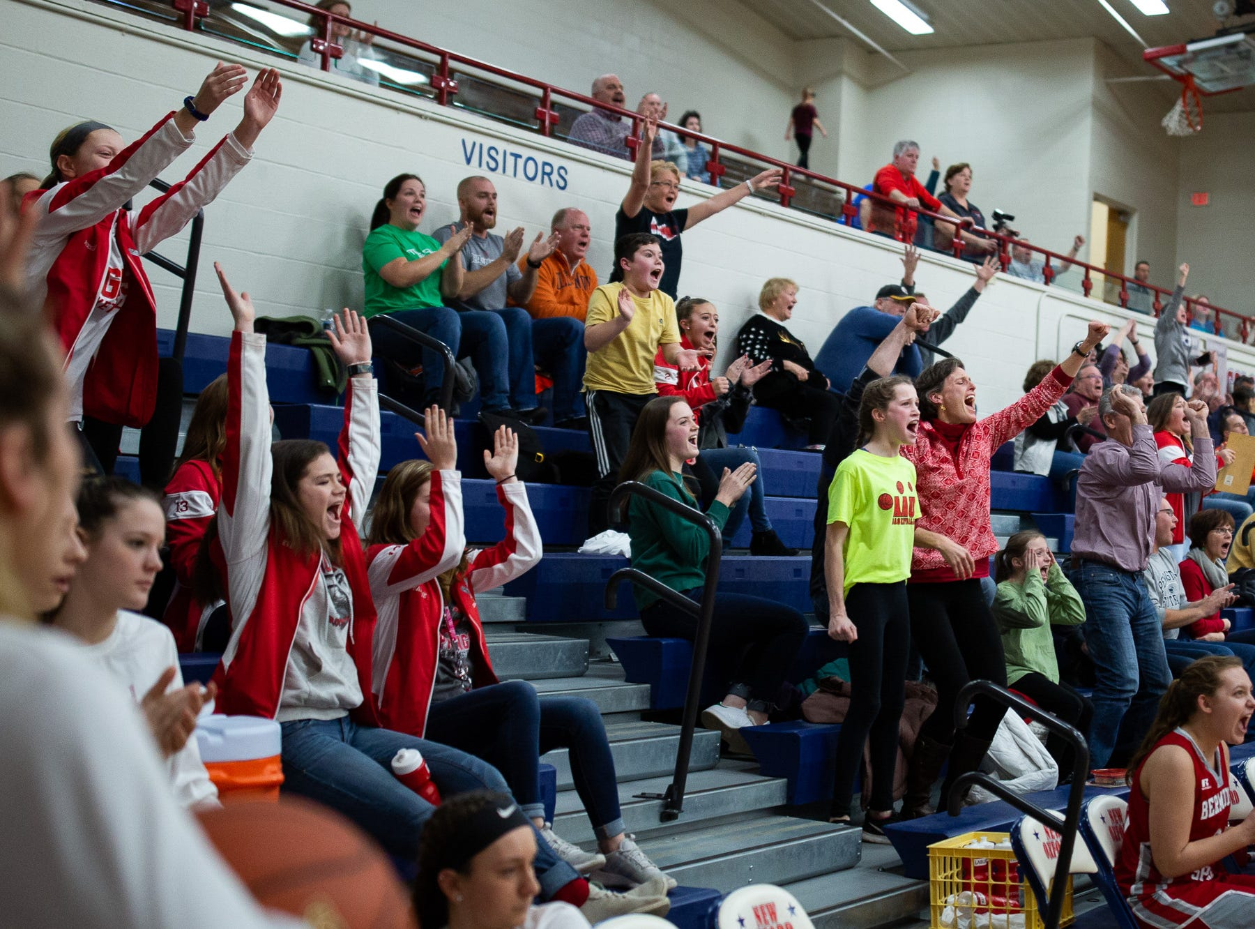 Bermudian Springs fans cheer in the final seconds of the consolation game between Bermudian Springs and York Suburban during the New Oxford Girls Basketball Tip-Off Tournament, Saturday, Dec. 8, 2018, in New Oxford. The Bermudian Springs Lady Eagles defeated the York Suburban Lady Trojans 60-58.