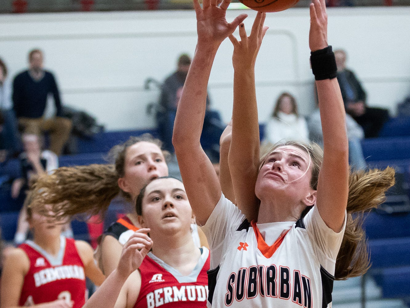 York Suburban's Elizabeth Mooney (12) shoots during the consolation game between Bermudian Springs and York Suburban during the New Oxford Girls Basketball Tip-Off Tournament, Saturday, Dec. 8, 2018, in New Oxford. The Bermudian Springs Lady Eagles defeated the York Suburban Lady Trojans 60-58.