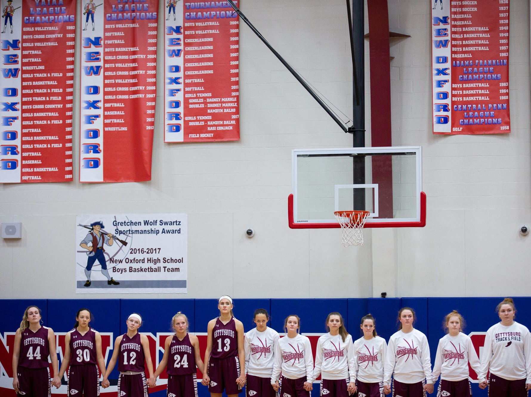 The Gettysburg Lady Warriors stand for the National Anthem during the championship game between New Oxford and Gettysburg at the New Oxford Girls Basketball Tip-Off Tournament, Saturday, Dec. 8, 2018, in New Oxford. The Gettysburg Lady Warriors defeated the New Oxford Lady Colonials 47-40.
