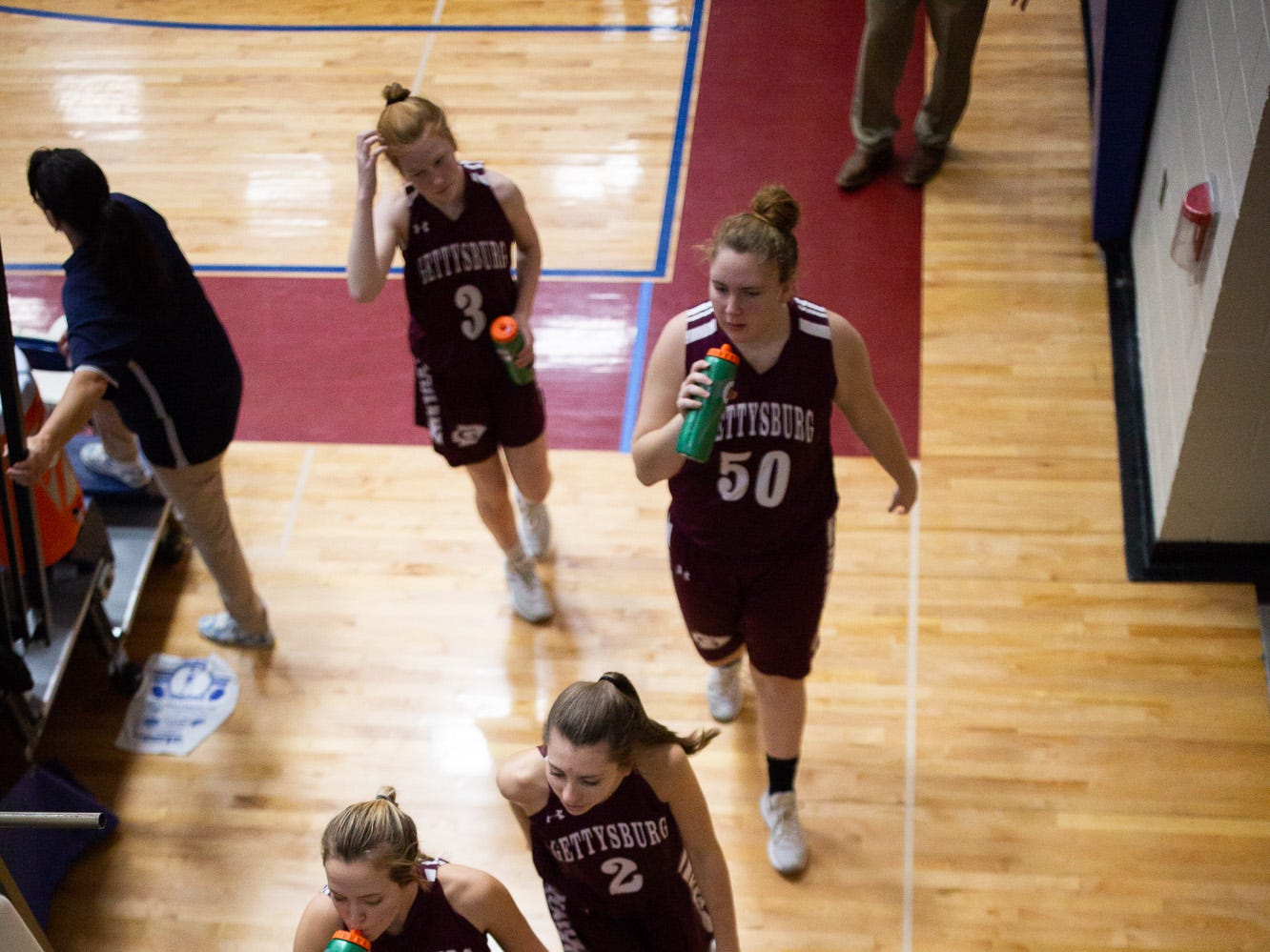 The Gettysburg Lady Warriors walk to the lockerroom for halftime during the championship game between New Oxford and Gettysburg at the New Oxford Girls Basketball Tip-Off Tournament, Saturday, Dec. 8, 2018, in New Oxford. The Gettysburg Lady Warriors defeated the New Oxford Lady Colonials 47-40.