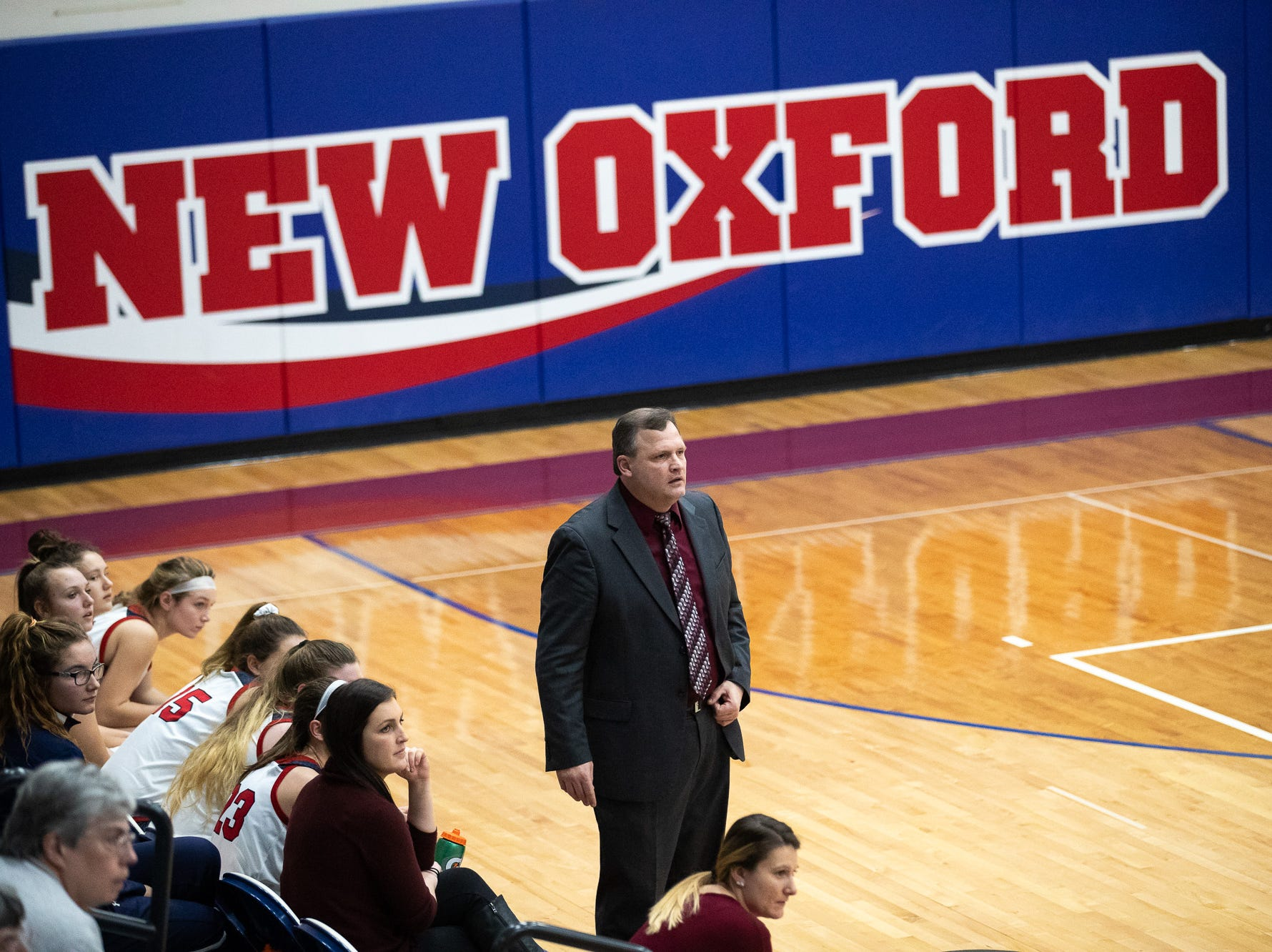 New Oxford coach Michael Englar looks on during the championship game between New Oxford and Gettysburg at the New Oxford Girls Basketball Tip-Off Tournament, Saturday, Dec. 8, 2018, in New Oxford. The Gettysburg Lady Warriors defeated the New Oxford Lady Colonials 47-40.