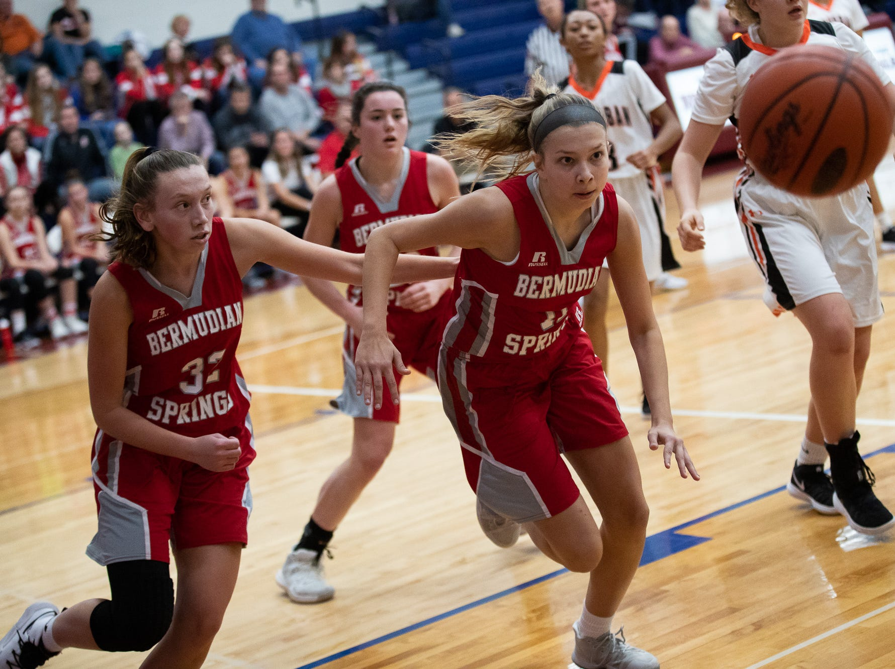 Bermudian Springs' Leah Bealmear (11) races towards the ball during the consolation game between Bermudian Springs and York Suburban during the New Oxford Girls Basketball Tip-Off Tournament, Saturday, Dec. 8, 2018, in New Oxford. The Bermudian Springs Lady Eagles defeated the York Suburban Lady Trojans 60-58.