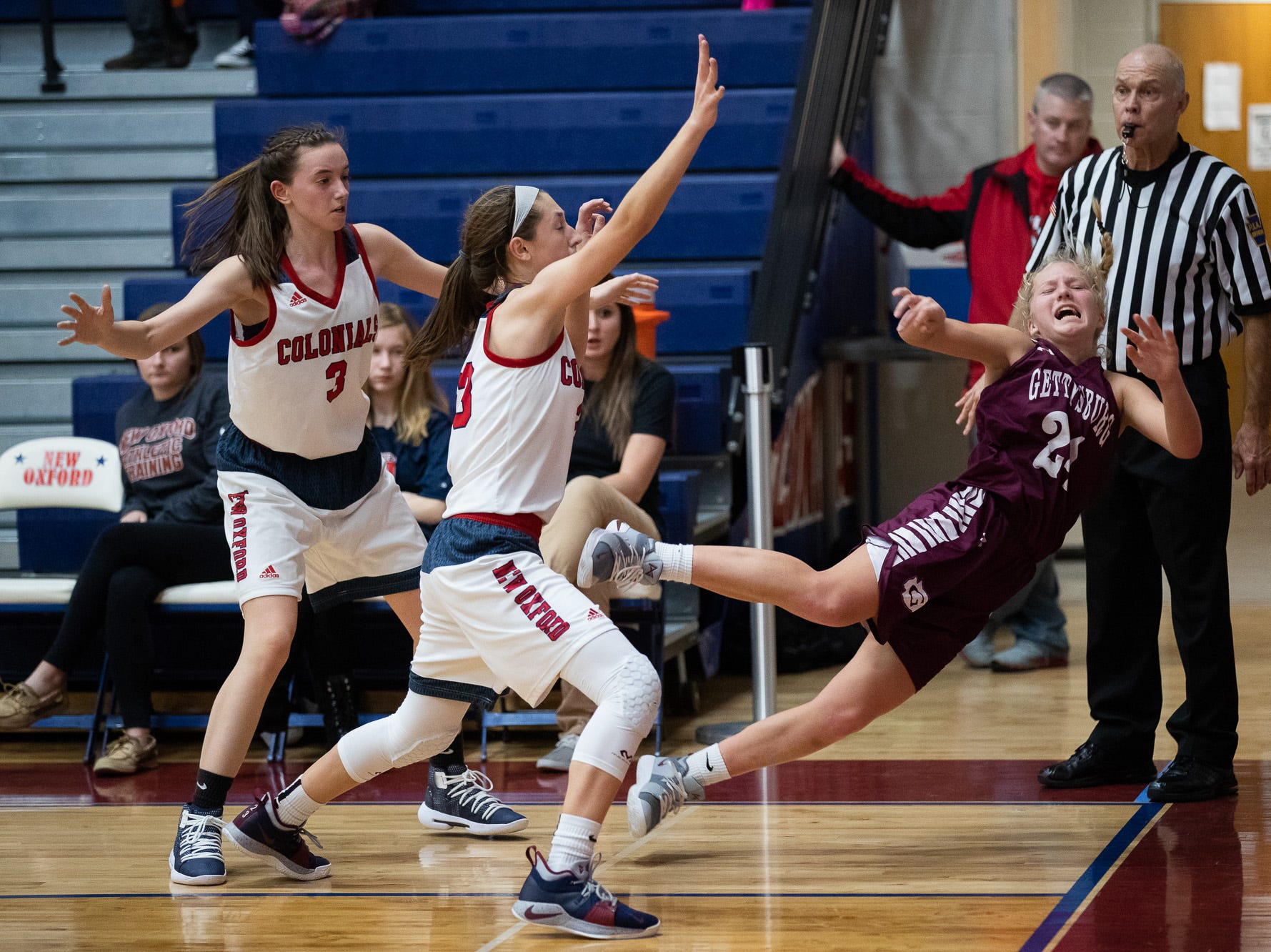 A Gettysburg player falls after throwing the ball during the championship game between New Oxford and Gettysburg at the New Oxford Girls Basketball Tip-Off Tournament, Saturday, Dec. 8, 2018, in New Oxford. The Gettysburg Lady Warriors defeated the New Oxford Lady Colonials 47-40.