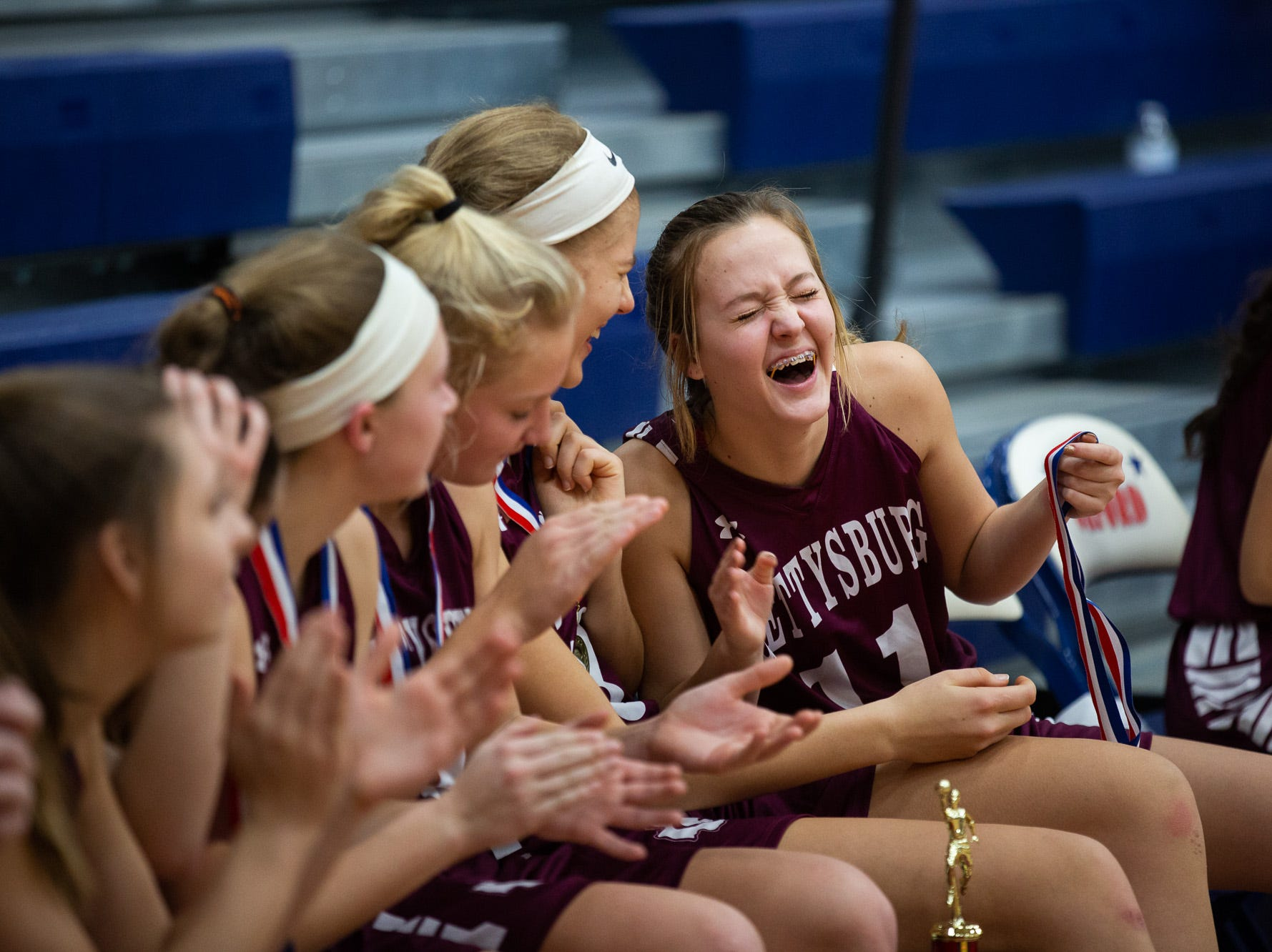 Gettysburg's Grace Witt (11) laughs with teammates after winning the championship game between New Oxford and Gettysburg at the New Oxford Girls Basketball Tip-Off Tournament, Saturday, Dec. 8, 2018, in New Oxford. The Gettysburg Lady Warriors defeated the New Oxford Lady Colonials 47-40.