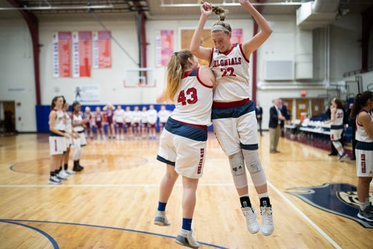 New Oxford's Morgan Adams (22) jumps with teammate Natalie Slusser (43) before the championship game between New Oxford and Gettysburg at the New Oxford Girls Basketball Tip-Off Tournament, Saturday, Dec. 8, 2018, in New Oxford. The Gettysburg Lady Warriors defeated the New Oxford Lady Colonials 47-40.