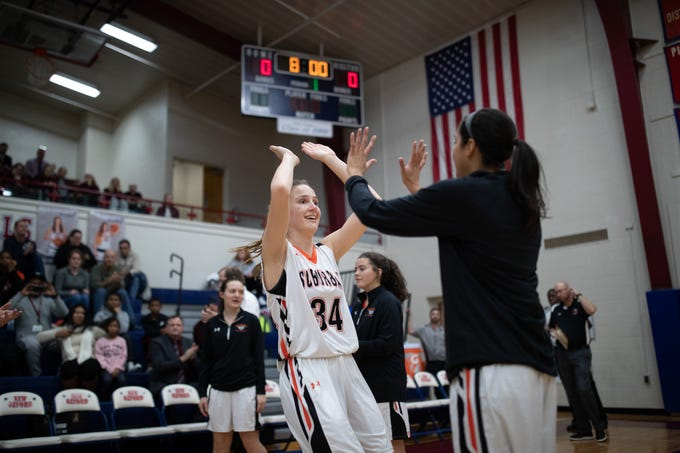 York Suburban's Maddison Perring (34) is introduced before the consolation game between Bermudian Springs and York Suburban during the New Oxford Girls Basketball Tip-Off Tournament, Saturday, Dec. 8, 2018, in New Oxford. The Bermudian Springs Lady Eagles defeated the York Suburban Lady Trojans 60-58.