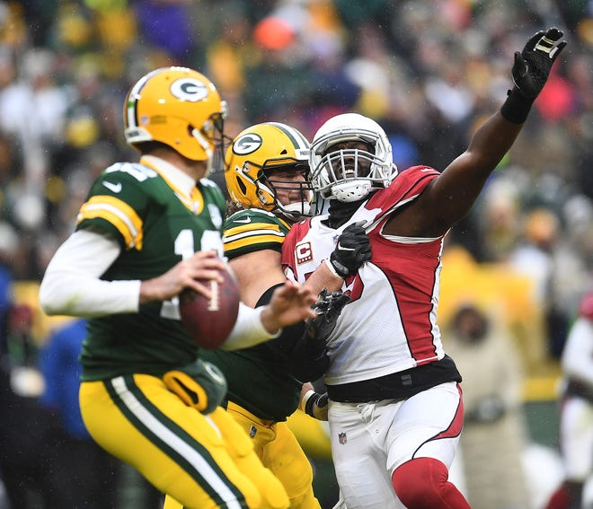 Chandler Jones #55 of the Arizona Cardinals attempts to get to Aaron Rodgers #12 of the Green Bay Packers during the second half of a game at Lambeau Field on December 02, 2018 in Green Bay, Wisconsin.