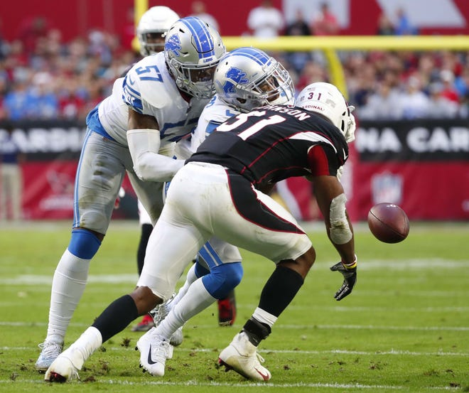 Arizona Cardinals running back David Johnson (31) fumbles the ball after a hit by Detroit Lions defensive back Marcus Cooper (21) during the first half in Glendale, Ariz. December 9. The Arizona Cardinals recovered the ball.