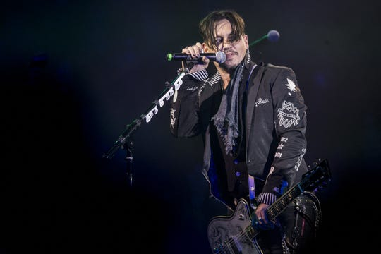 Johnny Depp of Hollywood Vampires performs during the 17th annual Alice Cooper's Christmas Pudding concert on Saturday, Dec. 8, 2018, at Celebrity Theatre in Phoenix.