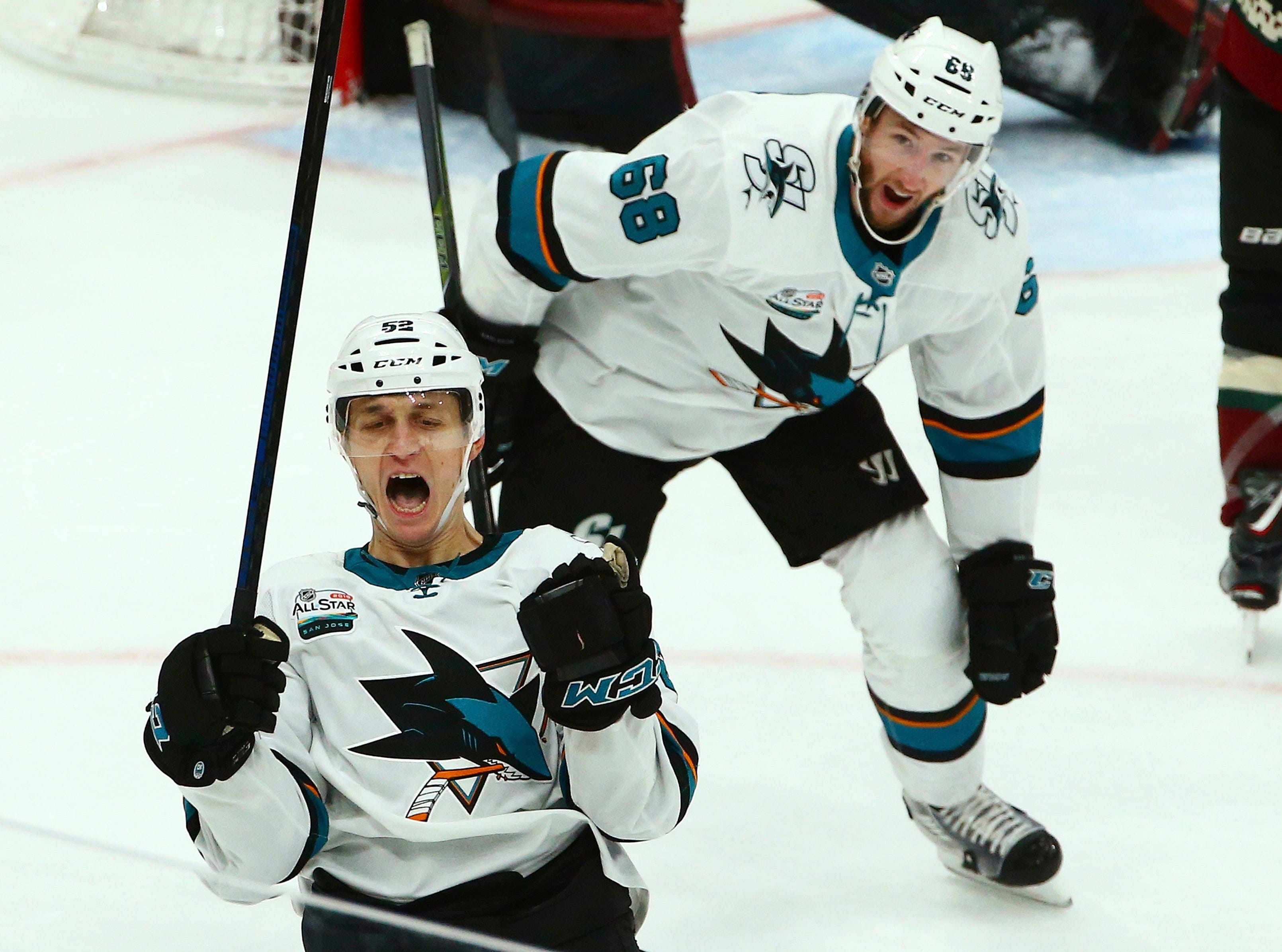 San Jose Sharks center Lukas Radil (52) celebrates his goal against the Arizona Coyotes as Sharks center Melker Karlsson (68) looks on during the third period of an NHL hockey game, Saturday, Dec. 8, 2018, in Phoenix. The Sharks defeated the Coyotes 5-3.
