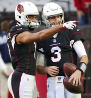 Arizona Cardinals wide receiver Larry Fitzgerald (11) talks with quarterback Josh Rosen (3) before playing against the Detroit Lions December 9.