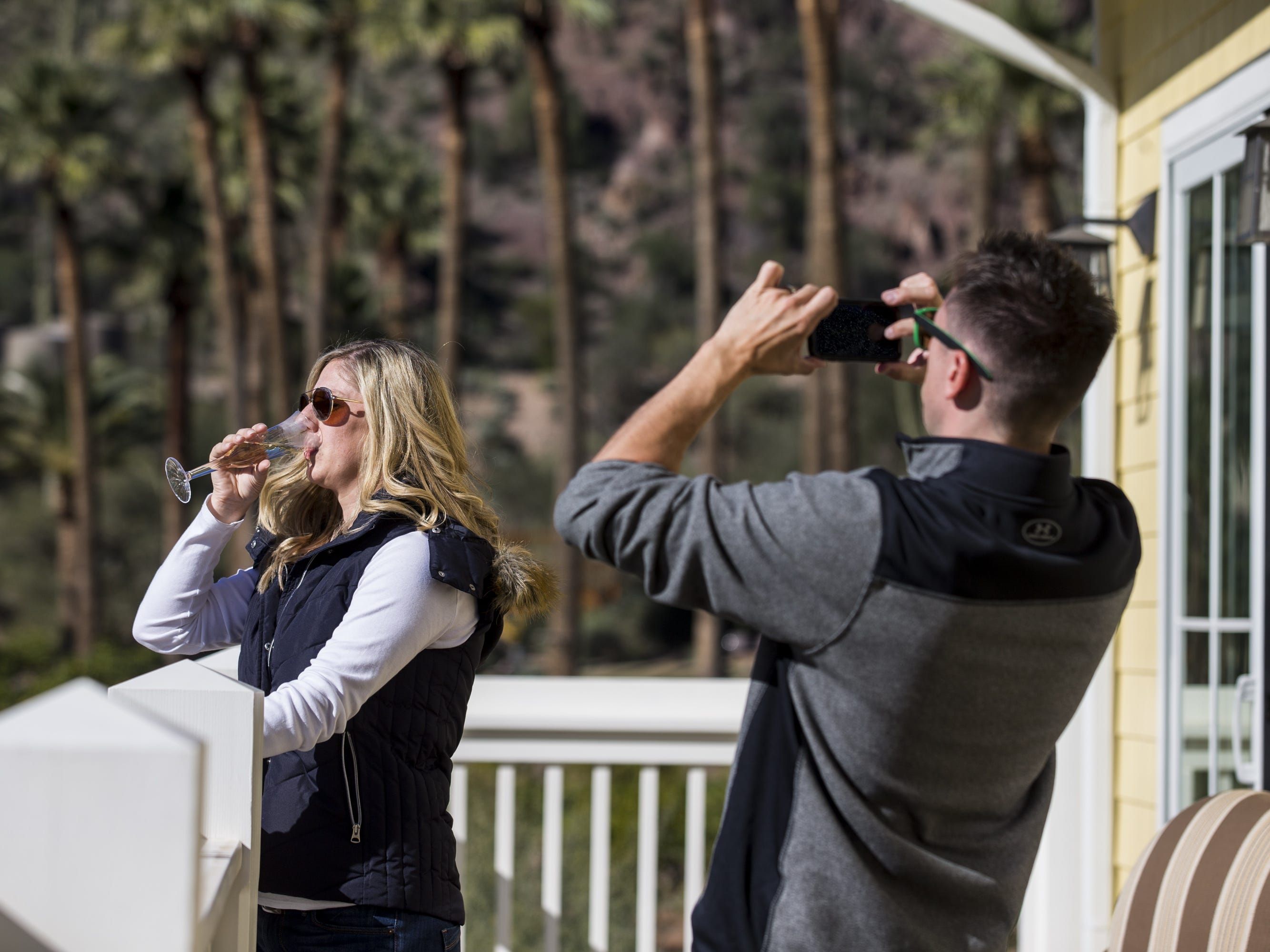 Jason Thiel takes a photo of Jodie Thiel during a private preview of the newly renovated Castle Hot Springs resort on Saturday, Dec. 8, 2018, in Morristown, Ariz. It has been 50 years since the resort has hosted any guests.