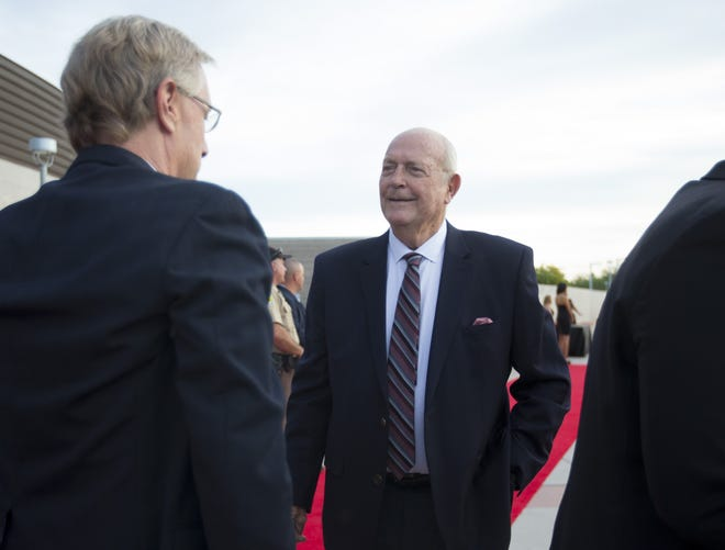 High school basketball coach Royce Youree walks the red carpet during the Arizona Sports Hall of Fame ceremony at Tempe Center for the Arts on October 27, 2016.