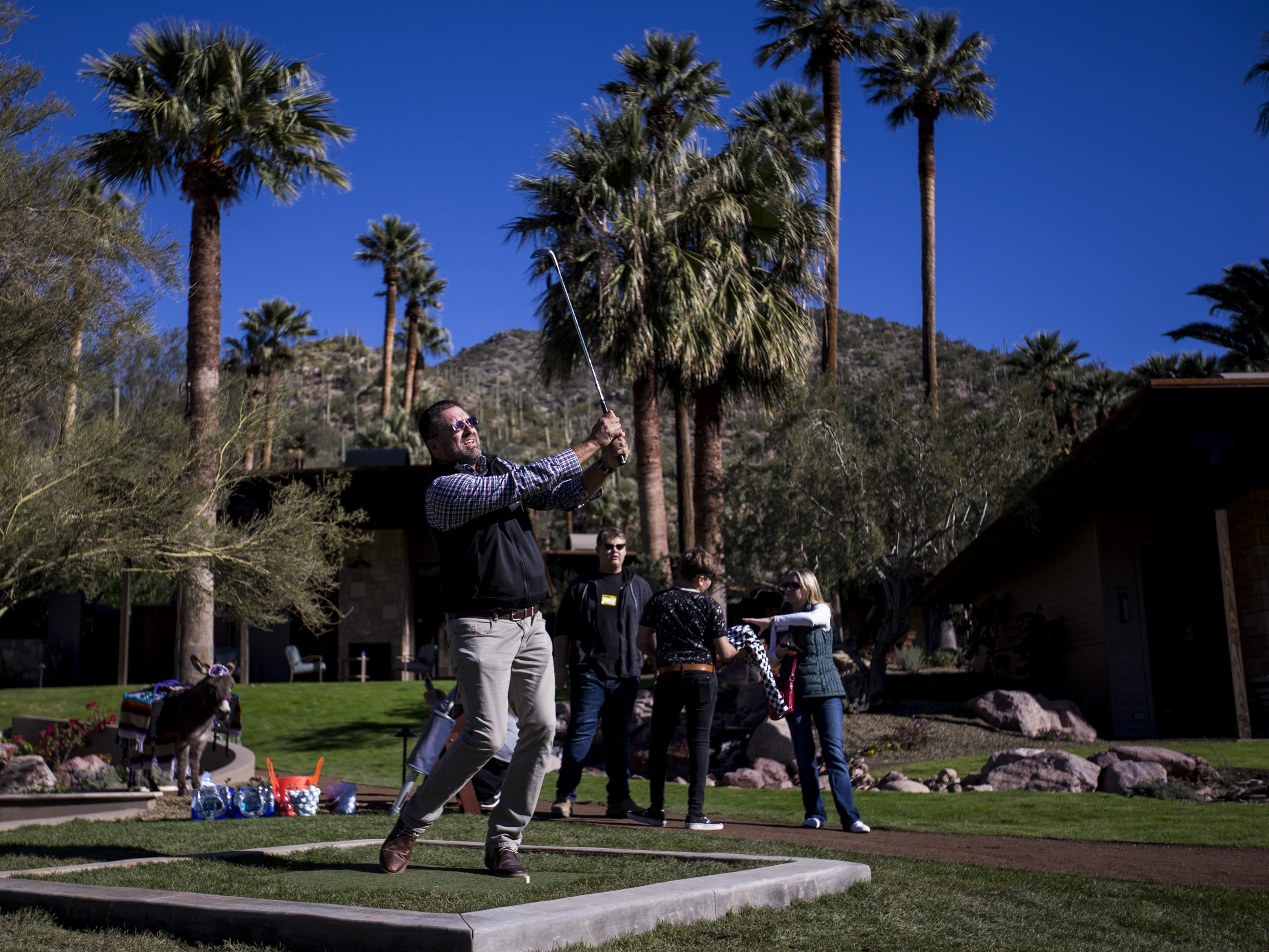 Mike Maras chips during a private preview of the newly renovated Castle Hot Springs resort on Saturday, Dec. 8, 2018, in Morristown, Ariz. It has been 50 years since the resort has hosted any guests.