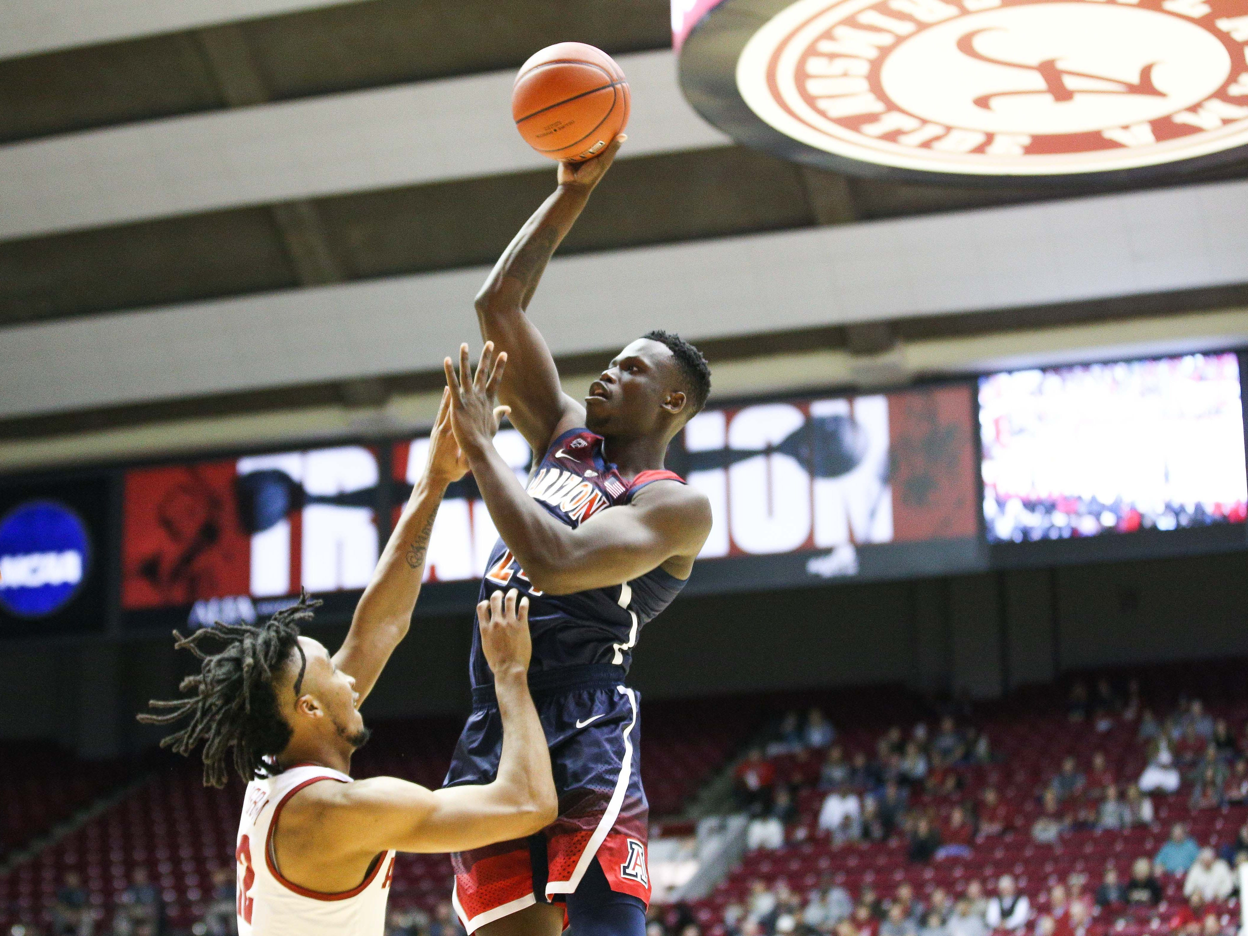 Dec 9, 2018; Tuscaloosa, AL, USA; Arizona Wildcats guard Emmanuel Akot (24) shoots over Alabama Crimson Tide guard Dazon Ingram (12) during the first half at Coleman Coliseum. Mandatory Credit: Marvin Gentry-USA TODAY Sports