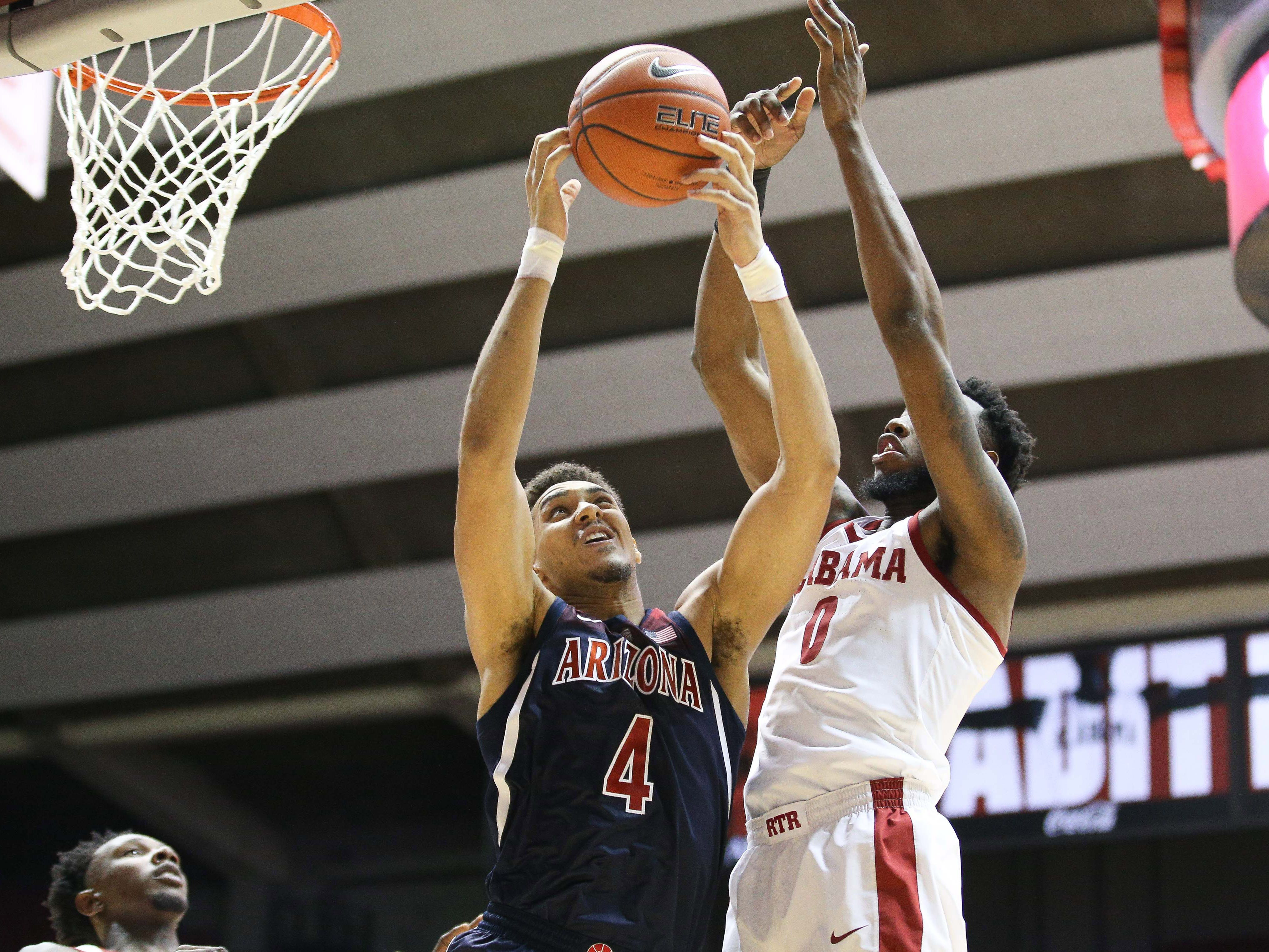 Dec 9, 2018; Tuscaloosa, AL, USA; Arizona Wildcats center Chase Jeter (4) grabs a rebound from Alabama Crimson Tide forward Donta Hall (0) during the first half at Coleman Coliseum. Mandatory Credit: Marvin Gentry-USA TODAY Sports