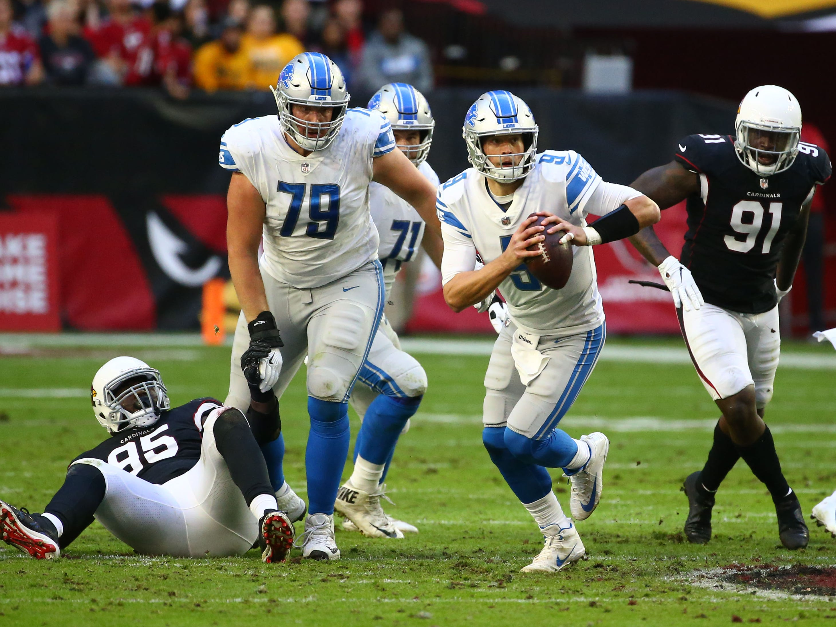 Detroit Lions quarterback Matthew Stafford runs with the ball against the Arizona Cardinals in the first half during a game on Dec. 9 at State Farm Stadium.