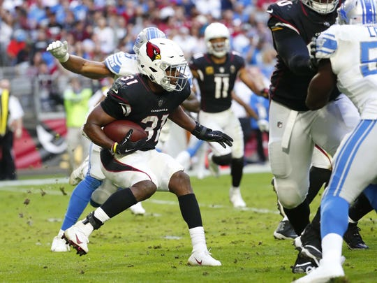 Arizona Cardinals running back David Johnson (31) looks for room to run against the Detroit Lions during the first half in Glendale, Ariz. December 9.