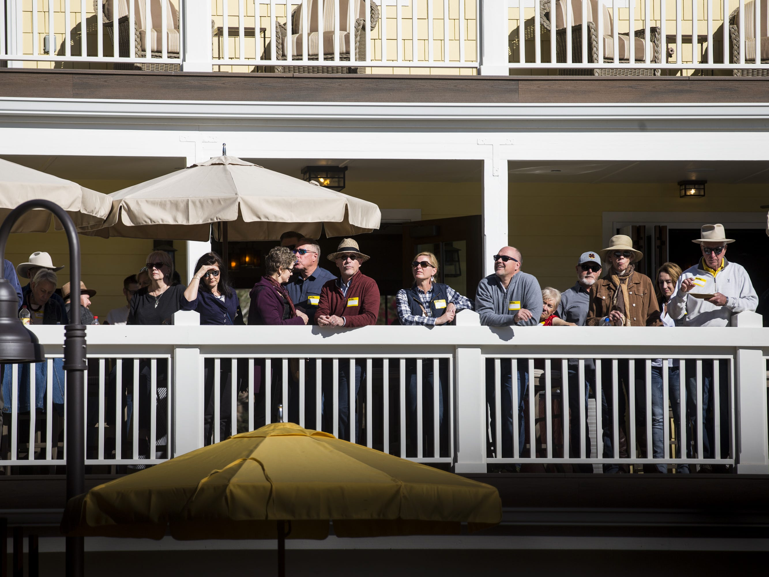 People watch the flag-raising ceremony during a private preview of the newly renovated Castle Hot Springs resort on Saturday, Dec. 8, 2018, in Morristown, Ariz. It has been 50 years since the resort has hosted any guests.