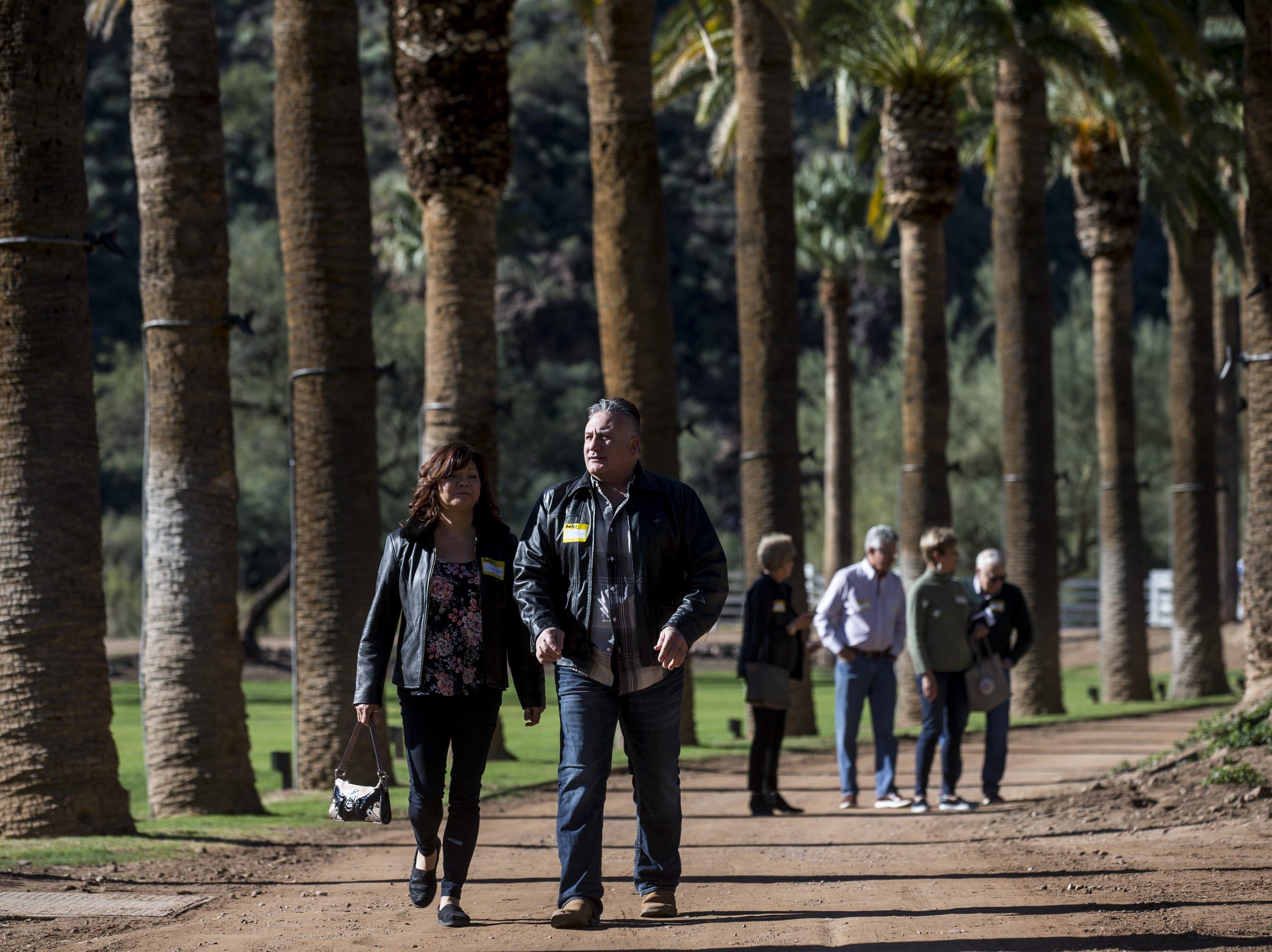 People arrive for a private preview of the newly renovated Castle Hot Springs resort on Saturday, Dec. 8, 2018, in Morristown, Ariz. It has been 50 years since the resort has hosted any guests.