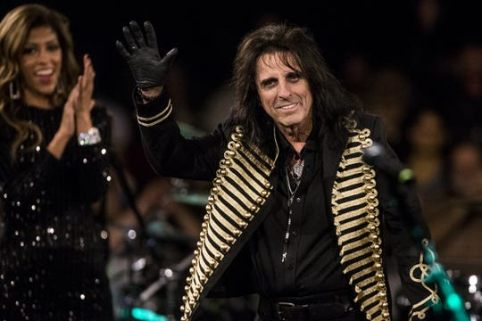 Alice Cooper waves to the crowd during the 17th annual Alice Cooper's Christmas Pudding concert on Saturday, Dec. 8, 2018, at Celebrity Theatre in Phoenix.