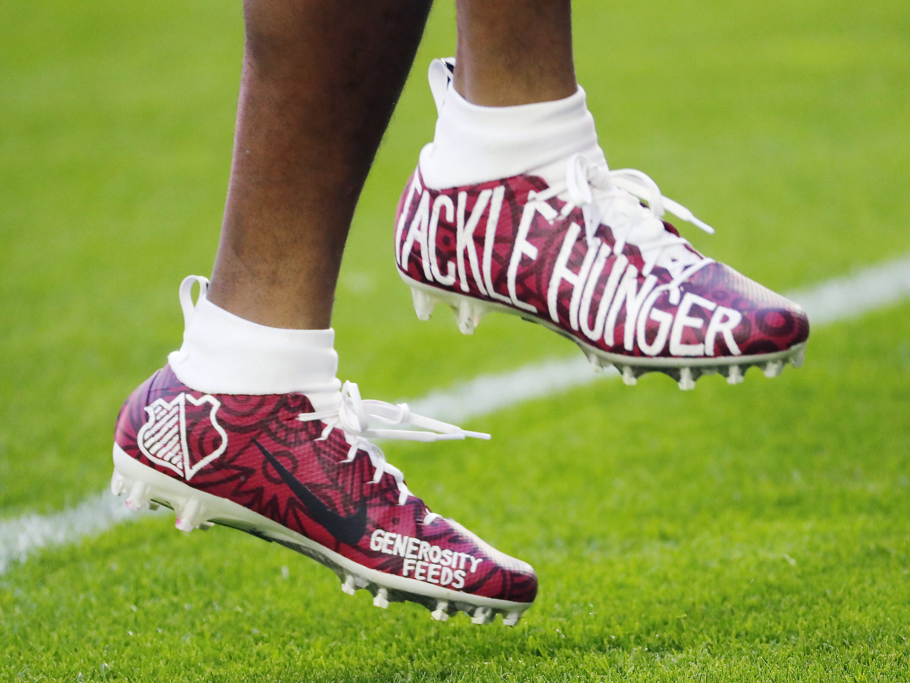 Arizona Cardinals strong safety Budda Baker (36) wears cleats as part of the NFL's My Cause My Cleats campaign before playing against the Detroit Lions December 9.