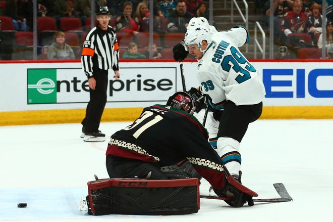 San Jose Sharks center Logan Couture (39) scores a goal against Arizona Coyotes goaltender Adin Hill (31) during the first period of an NHL hockey game, Saturday, Dec. 8, 2018, in Phoenix.