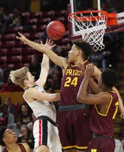 Brophy's Ben Paul (21) puts a shot up against Mountain Pointe's Jalen Graham (24) during the 6A boys basketball semifinal at Wells Fargo Arena in Tempe, Ariz. February 21, 2018.