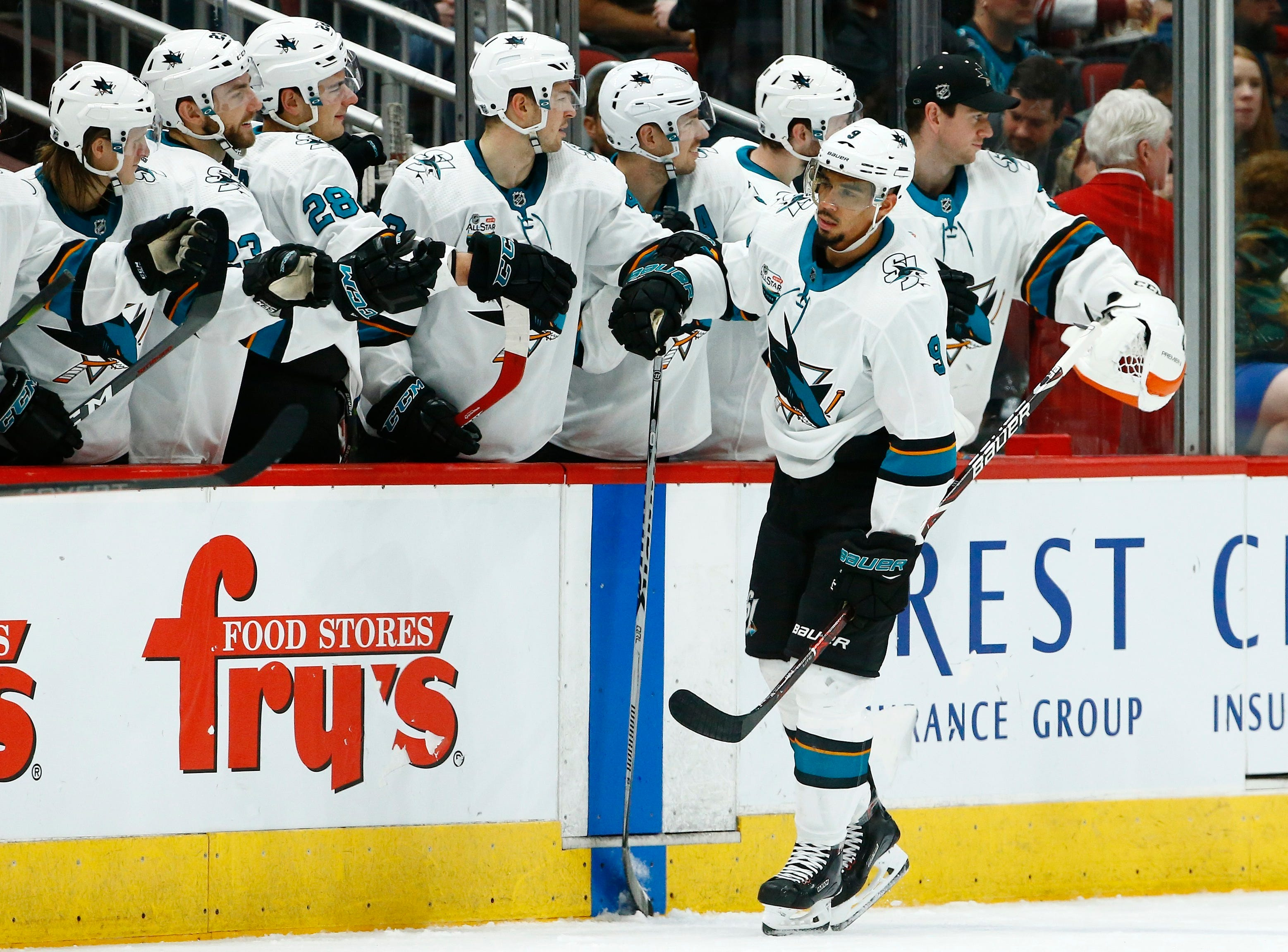 San Jose Sharks left wing Evander Kane (9) celebrates his goal against the Arizona Coyotes during the second period of an NHL hockey game, Saturday, Dec. 8, 2018, in Phoenix. (AP Photo/Ross D. Franklin)