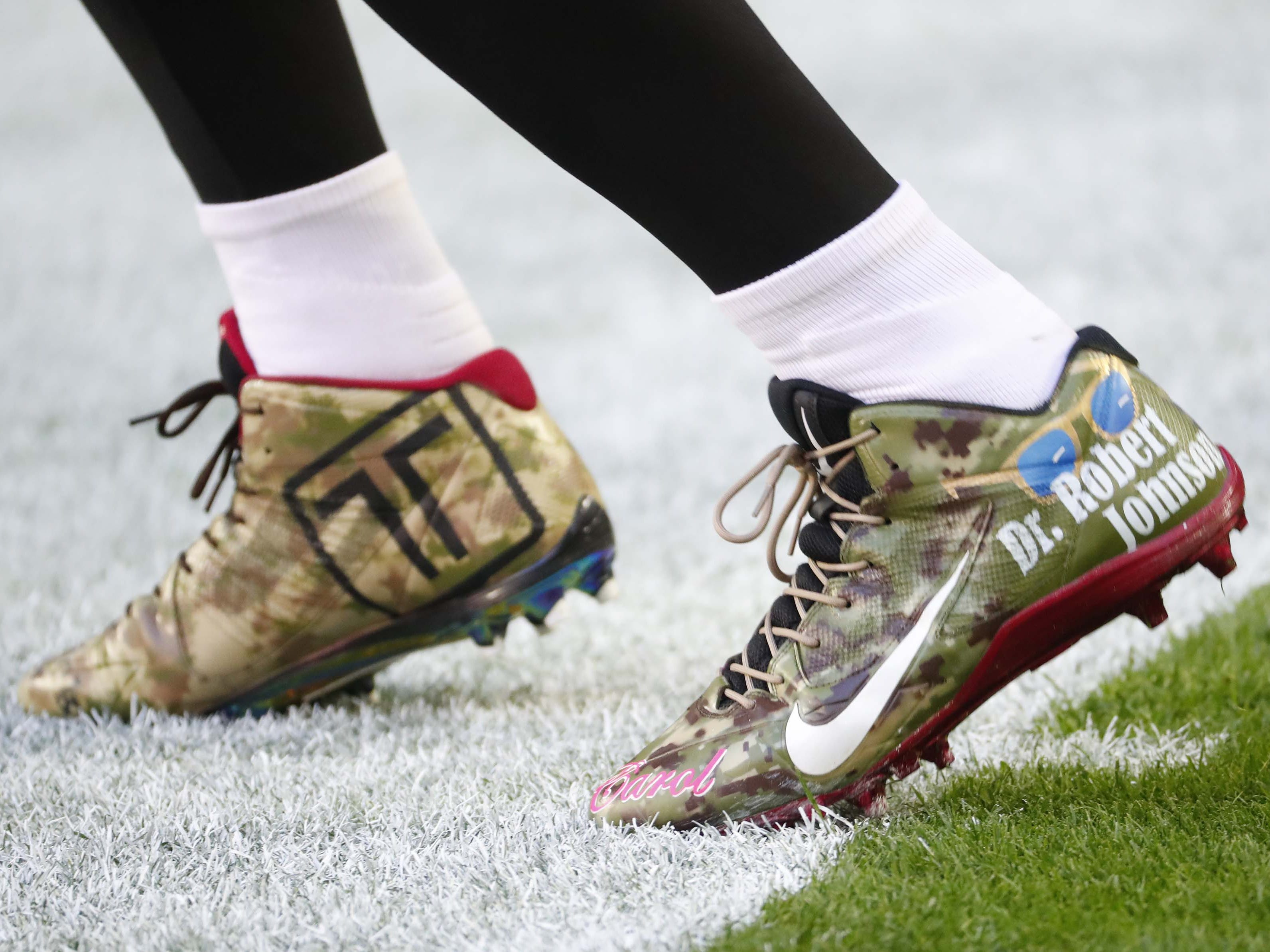 Arizona Cardinals wide receiver Larry Fitzgerald (11) wears cleats as part of the NFL's My Cause My Cleats campaign before playing against the Detroit Lions December 9.