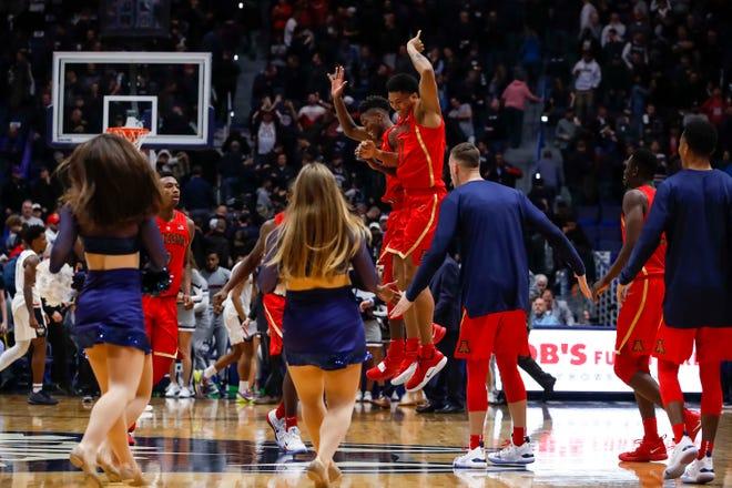 Dec 2, 2018: Arizona Wildcats guard Brandon Randolph (5) and Arizona Wildcats forward Ira Lee (11) react after defeating the Connecticut Huskies at XL Center. Arizona defeated UConn 76-72.
