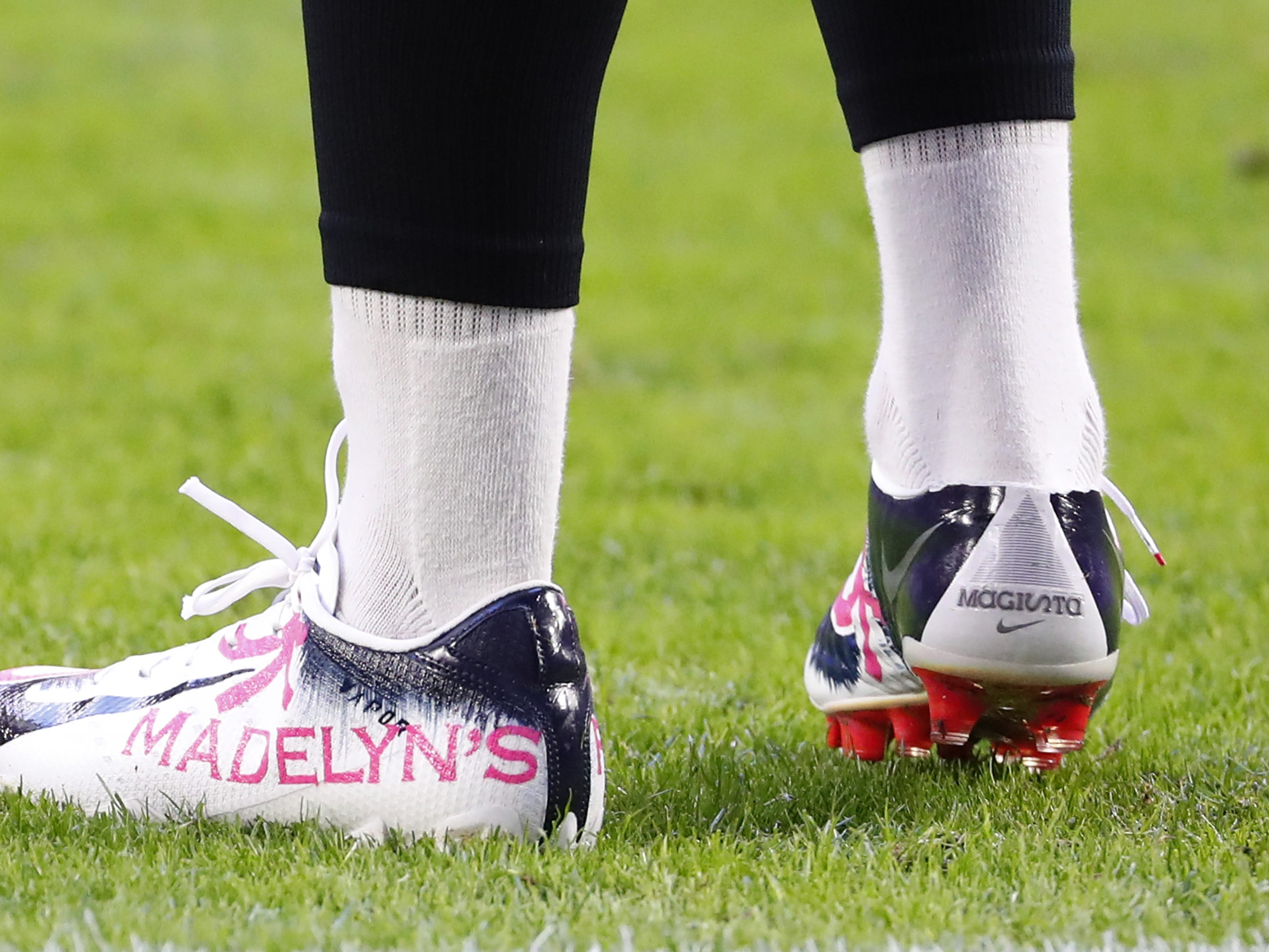 Arizona Cardinals punter Andy Lee (2) wears cleats as part of the NFL's My Cause My Cleats campaign before playing against the Detroit Lions December 9.