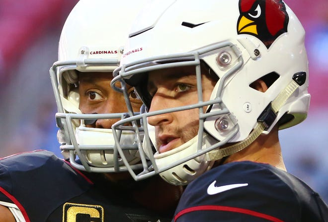 Arizona Cardinals Larry Fitzgerald and Josh Rosen talk before playing the Detroit Lions during a game on Dec. 9 at State Farm Stadium.