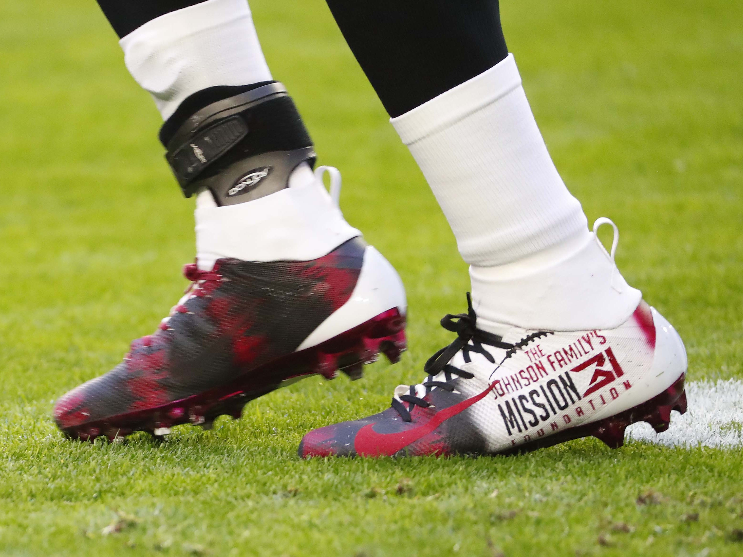 Arizona Cardinals running back David Johnson (31) wears cleats as part of the NFL's My Cause My Cleats campaign before playing against the Detroit Lions December 9.