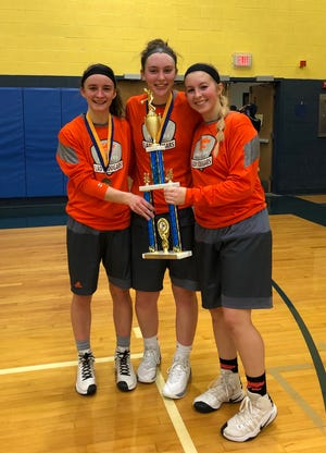 Palmyra seniors, from left, Amelia Baldo, Olivia Richardson and Sara Boyer celebrate their championship in the Northern Lebanon Lady Vikings' Tip-Off Tournament.