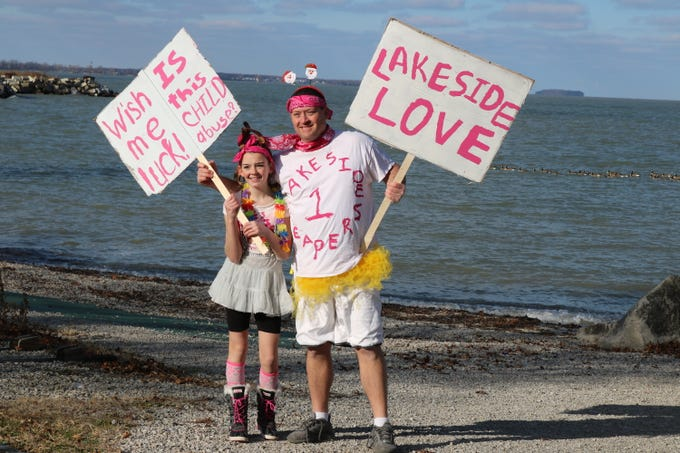"""Chris and Makenna Langford, of Oregon, Ohio, pose for a photo before plunging into Lake Erie for the """"Jingle Jump"""" at Lakeside on Saturday."""