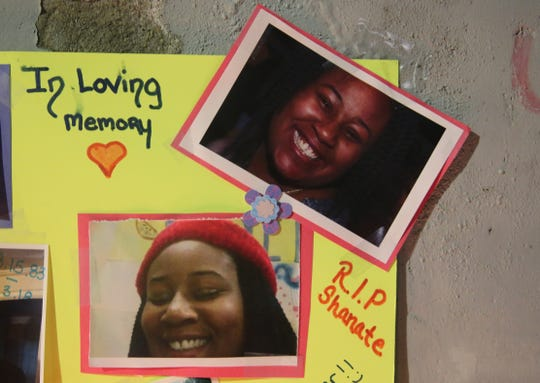 Photos and messages pay tribute to Long Island resident Shanate Fowler, one of the four victims who died in Monday's fire. The tribute sat in front of 61 Academy St. on Saturday night along with burning candles.