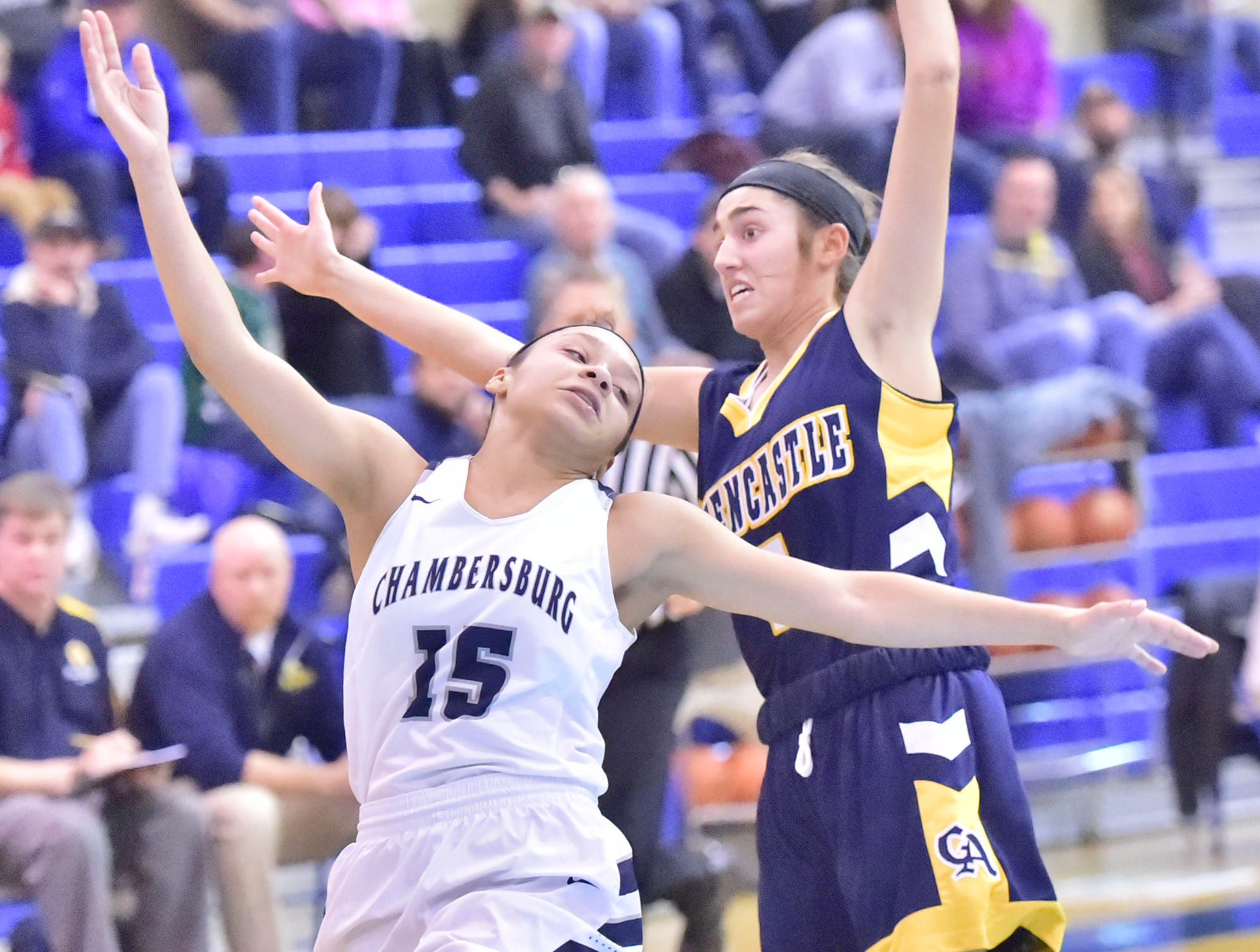 Chambersburg's Bre'ya Clooper (15) gets position with Greencastle's McKenna Rakaczewski Chambersburg played Greencastle during the finals at Franklin County Tip-Off Tournament, Saturday, Dec. 8, 2018.