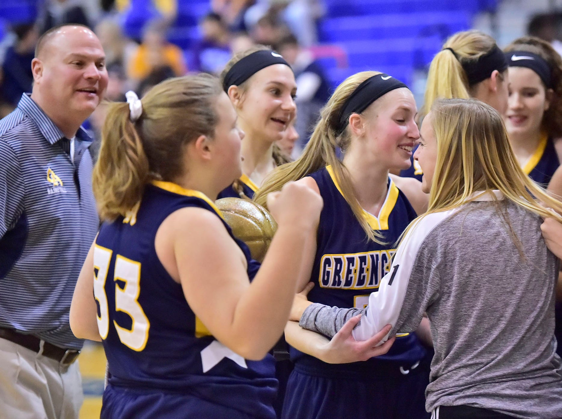 Greencastle teammates celebrate after a  26-22 win over Chambersburg during the finals at Franklin County Tip-Off Tournament, Saturday, Dec. 8, 2018.
