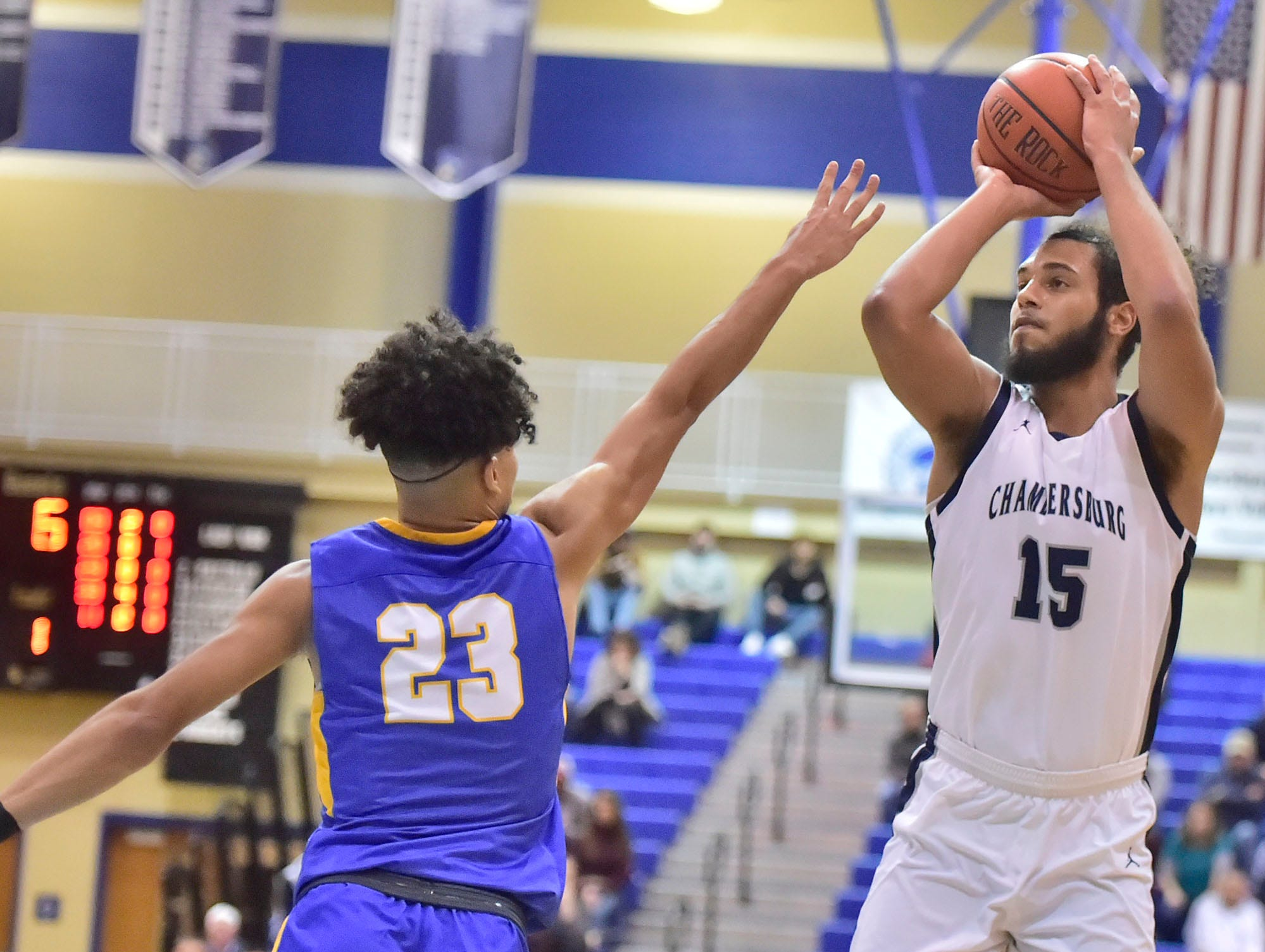 Chambersburg's Tyler Collier (15) shoots over Jay Alvarez (23) of Waynesboro during the finals at Franklin County Tip-Off Tournament, Saturday, Dec. 8, 2018.
